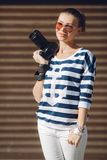 The female photographer with the digital camera Stock Images