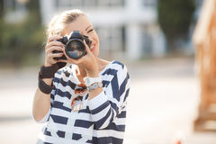 The female photographer with the digital camera Royalty Free Stock Photo