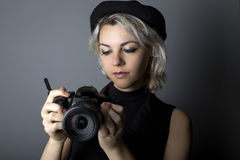 Female Photographer with DSLR Camera Stock Photography