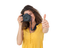 Female photographer gesturing thumbs up Stock Photography