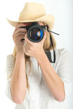 Female photographer with hat Stock Images
