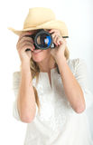 Female photographer with hat taking a picture Royalty Free Stock Photo