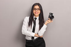 Female photographer holding a camera Stock Photography