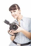 Female Photographer Holding a Camera and Smiling. Vertical Image. Isolated Over White Royalty Free Stock Photo