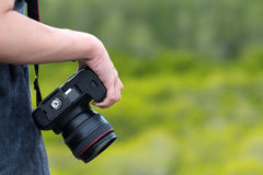 Female photographer holding dslr camera Royalty Free Stock Images
