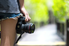 Female photographer holding dslr camera Stock Photos
