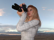 Female Photographer. Image of a female photographer Royalty Free Stock Photo