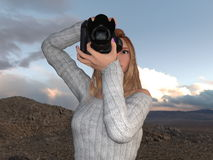 Female Photographer. Image of a female photographer Stock Photos