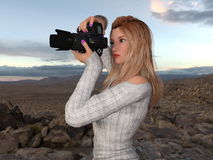 Female Photographer. Image of a female photographer Stock Photo