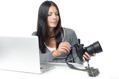 Female photographer inserting a card in her camera Royalty Free Stock Image