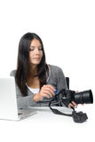 Female photographer inserting a card in her camera Stock Image
