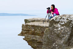 Female photographer in Irish scenery Stock Images