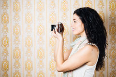 Female photographer with old camera Royalty Free Stock Images