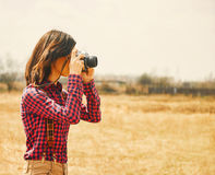 Female photographer with old photo camera Royalty Free Stock Photo