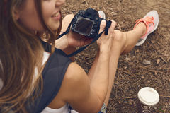Female photographer outdoors Stock Photography