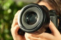 Female photographer with professional camera royalty free stock image