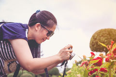 Female photographer with professional digital camera. Retro styl Royalty Free Stock Photography