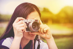 Female photographer with professional digital camera. Retro styl Royalty Free Stock Photos