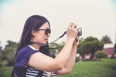 Female photographer with professional digital camera. VRetro sty Stock Photo