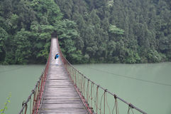 Female photographer and Rope Bridge Stock Photo