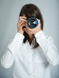 Female photographer shooting Royalty Free Stock Photos