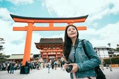 Female photographer shooting holding slr camera royalty free stock images