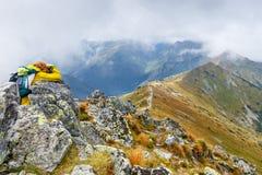 Female photographer shooting a mountain scenery Stock Photos