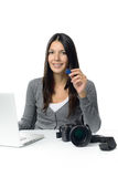 Female photographer showing sd card with her pictures Royalty Free Stock Photography