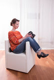 Female Photographer sitting in armchair Stock Images