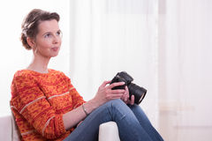 Female Photographer sitting in armchair Stock Image
