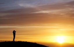 Female photographer in sunset Stock Image