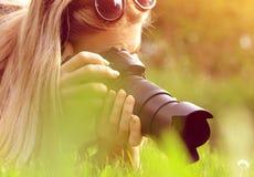 Female photographer take photo. Female photographer take photo on meadow Stock Photos