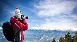 Female photographer take picture of winter landscape Royalty Free Stock Photos