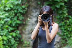 Female photographer takes photo Royalty Free Stock Images