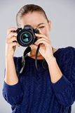 Female photographer taking a photo Royalty Free Stock Images