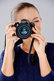 Female photographer taking a photo Stock Image