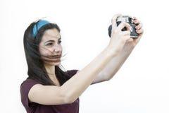 Female photographer taking shots Royalty Free Stock Image