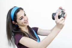 Female photographer taking shots Stock Photos