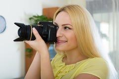 Female photographer testing new camera Stock Photos