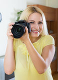 Female photographer testing new camera Royalty Free Stock Images