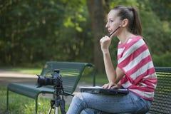 Female Photographer thinking Royalty Free Stock Photography