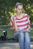 Female photographer thinking Royalty Free Stock Image
