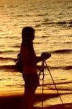 Female photographer under sunset Royalty Free Stock Image