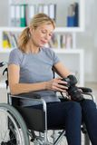 Female photographer in wheelchair holding professional camera royalty free stock photos