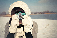Female photographer in winter Royalty Free Stock Images