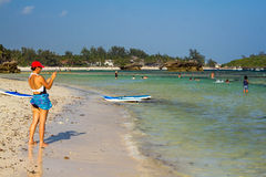 Female photographer. A woman takes pictures at a beach in Watamu, Kenya Royalty Free Stock Image