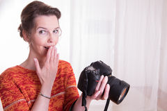 Female Photographer at work with camera Royalty Free Stock Images