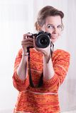 Female Photographer at work with camera Stock Images