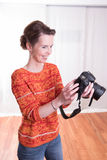 Female Photographer at work with camera Royalty Free Stock Photo