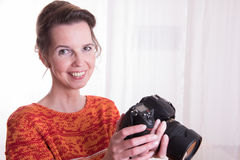 Female Photographer at work with camera Stock Photo